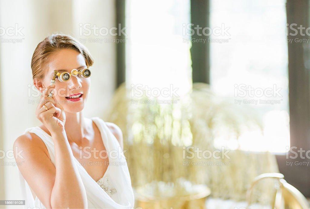 Woman Looking Through Opera Glasses royalty-free stock photo
