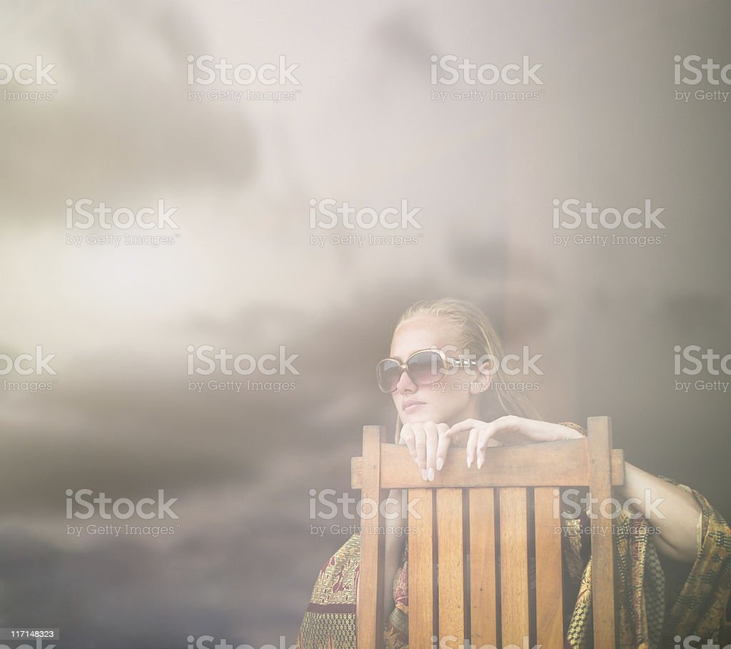Woman looking through the window at sunset royalty-free stock photo
