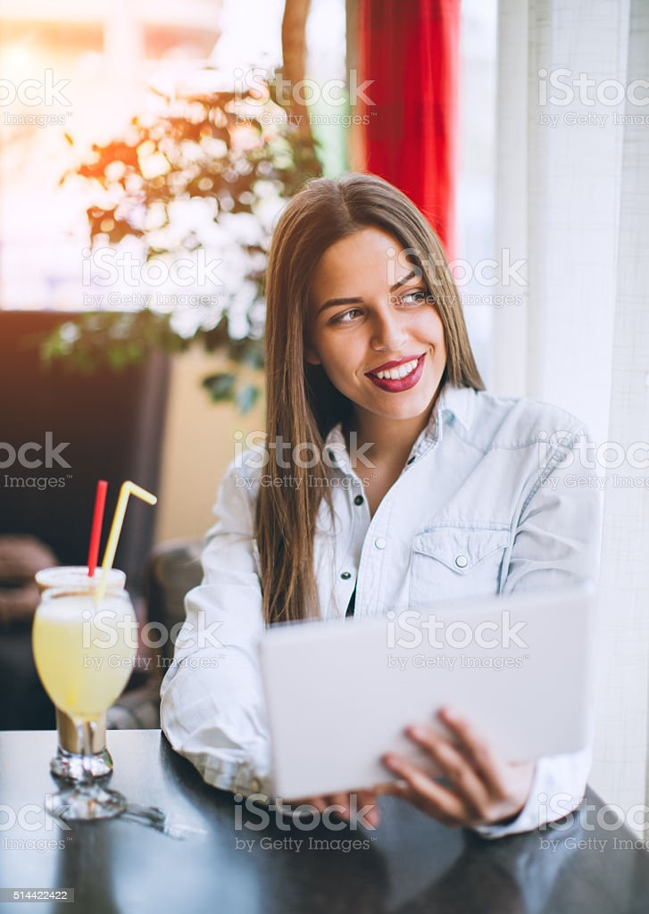 Woman looking through the window stock photo