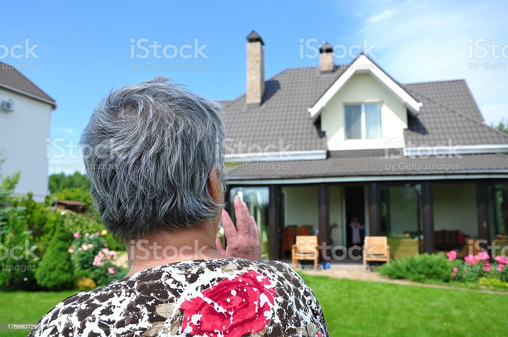 woman looking to a house stock photo