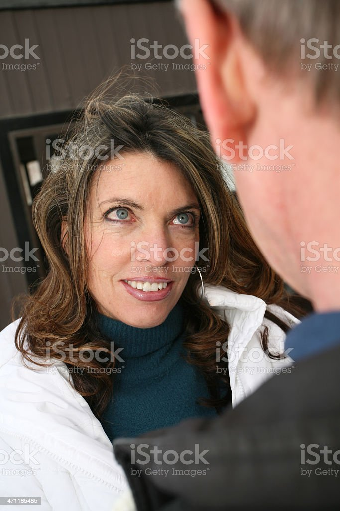 Woman looking to her man at a ski lodge stock photo
