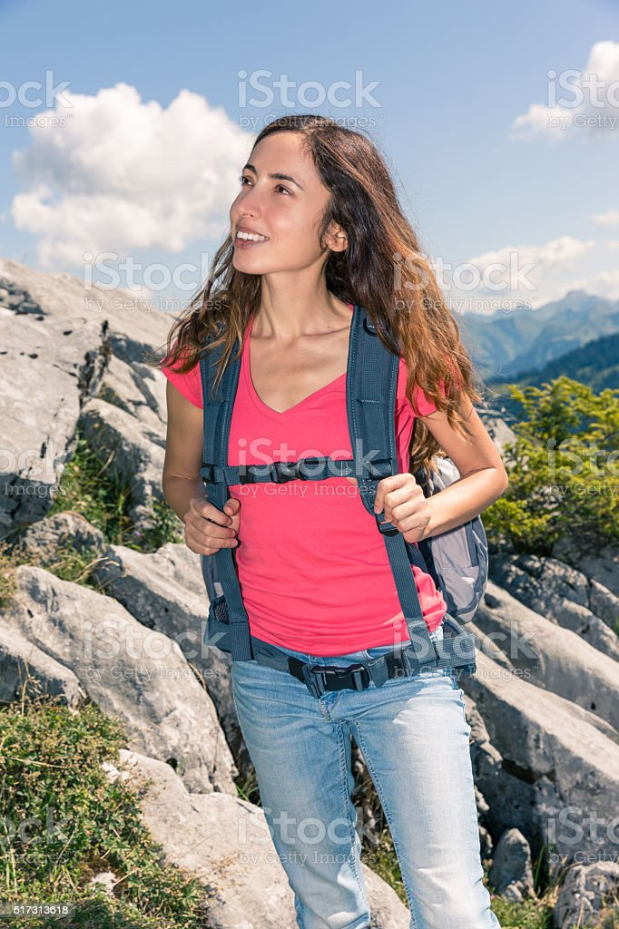 Woman looking to landscpae during hiking stock photo