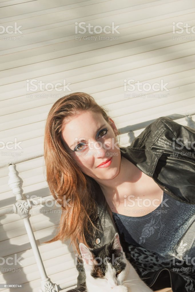 woman looking to the kitty stock photo