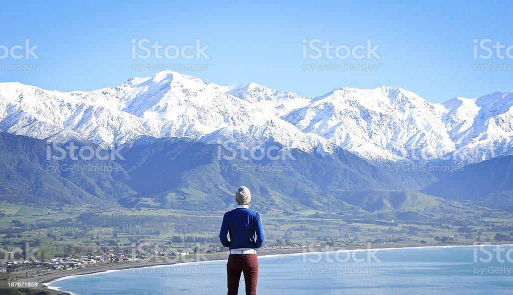 Woman looking to view of mountain scenery Kaikoura New Zealand stock photo