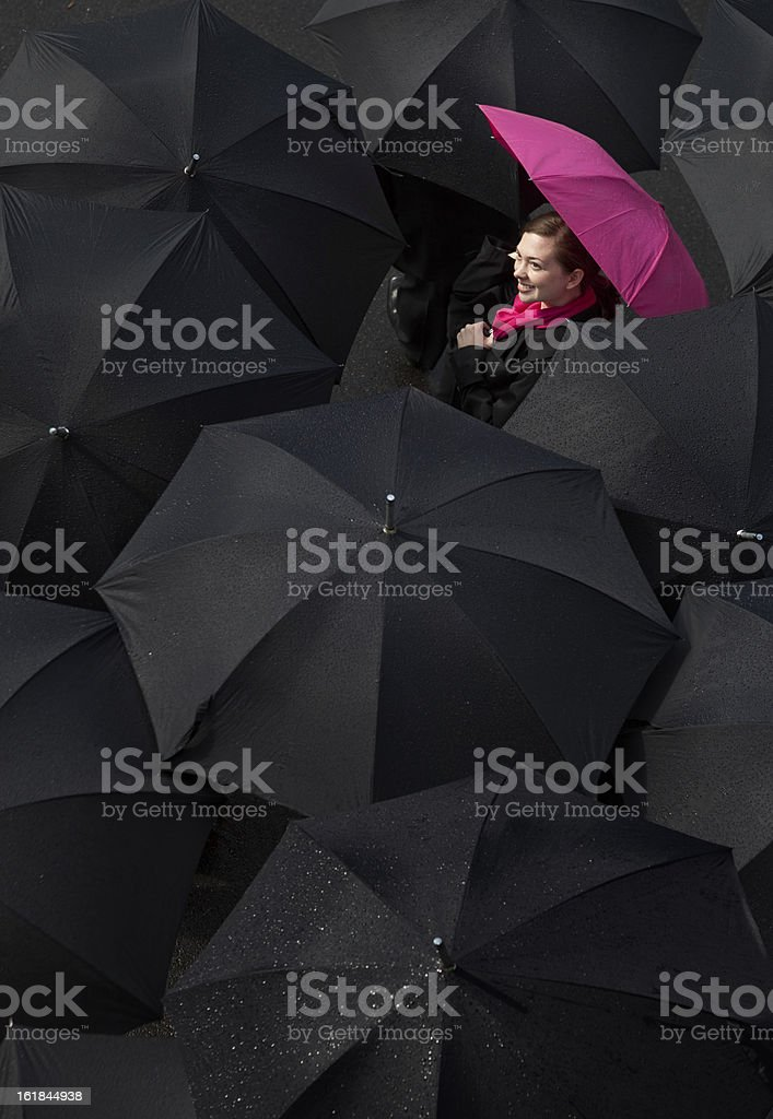 Woman looking up from under an umbrella royalty-free stock photo