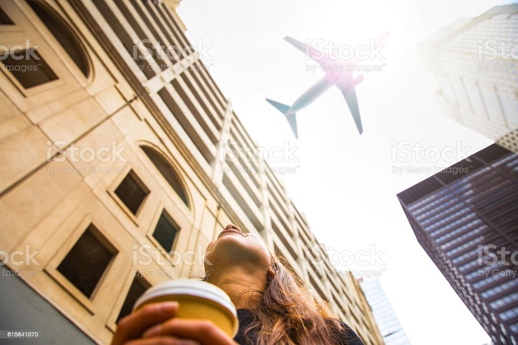 Woman looking up in Chicago downtown stock photo