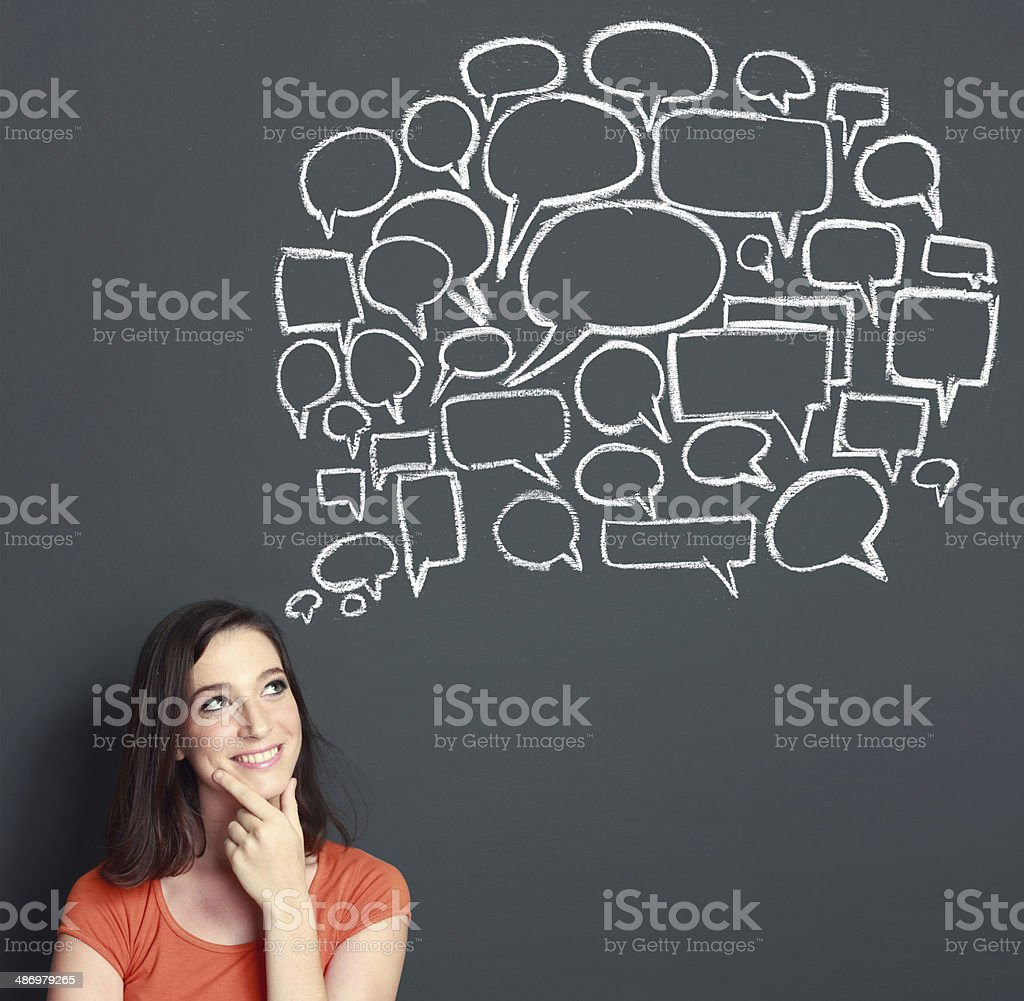 woman looking up to bubble speech stock photo