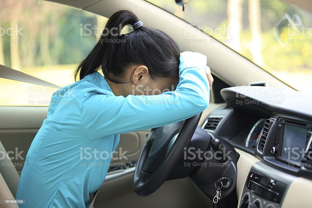 A woman looking upset in a car royalty-free stock photo