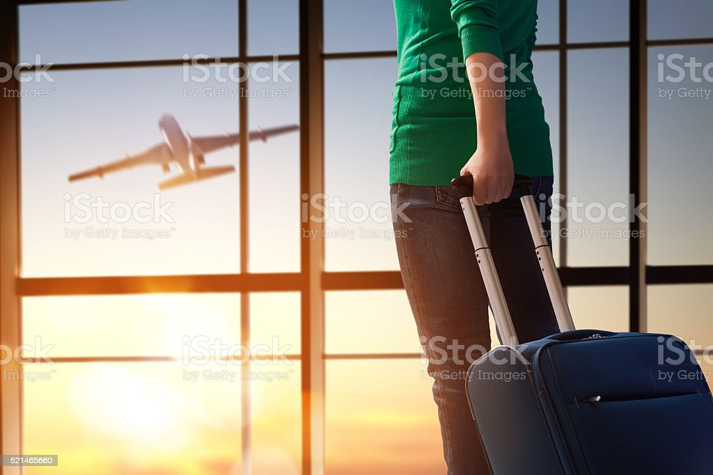 woman looks at a plane stock photo