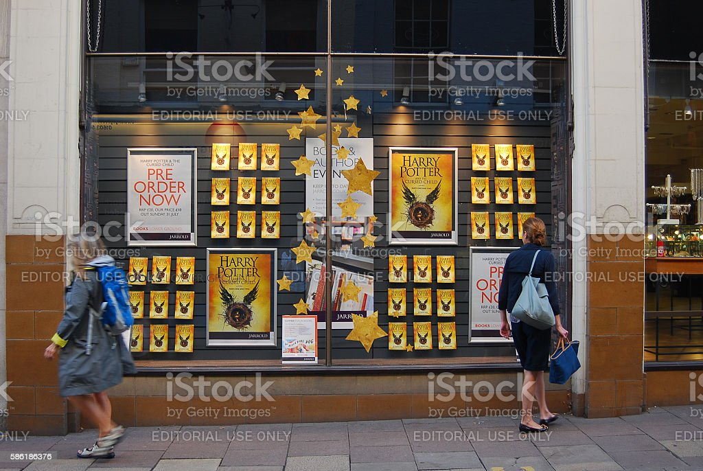 Woman looks at Bookstore window stock photo