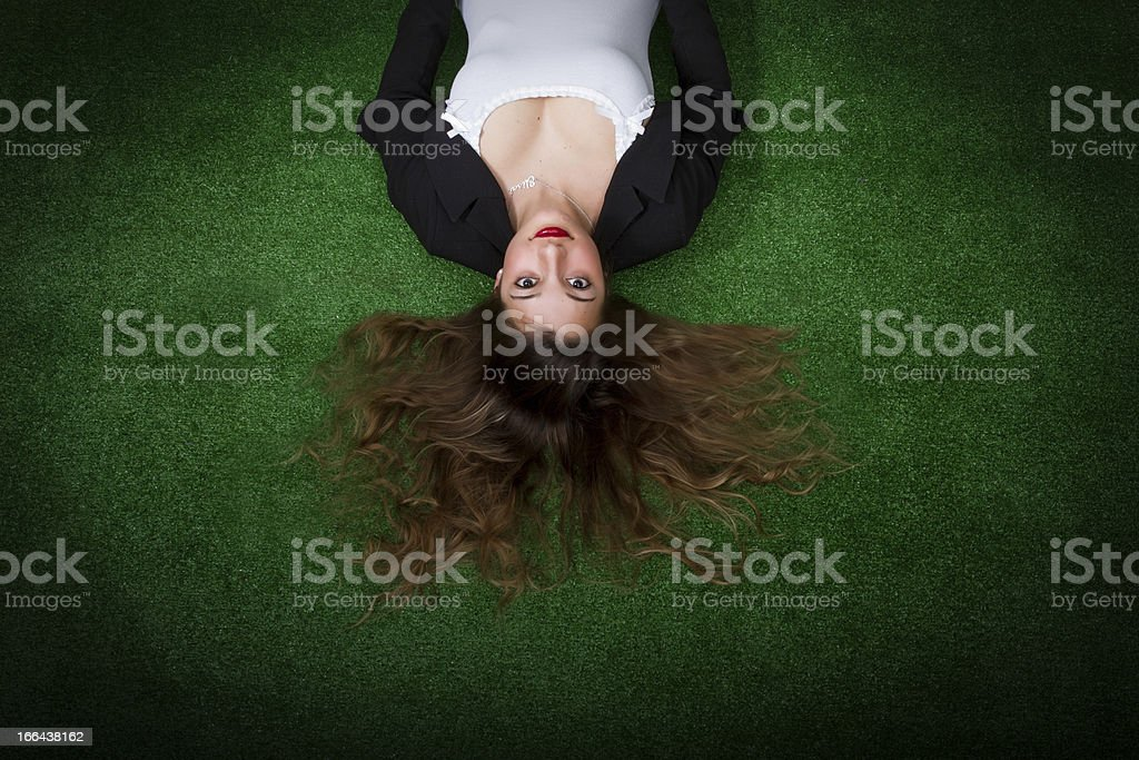 woman looks at sky lying on field royalty-free stock photo