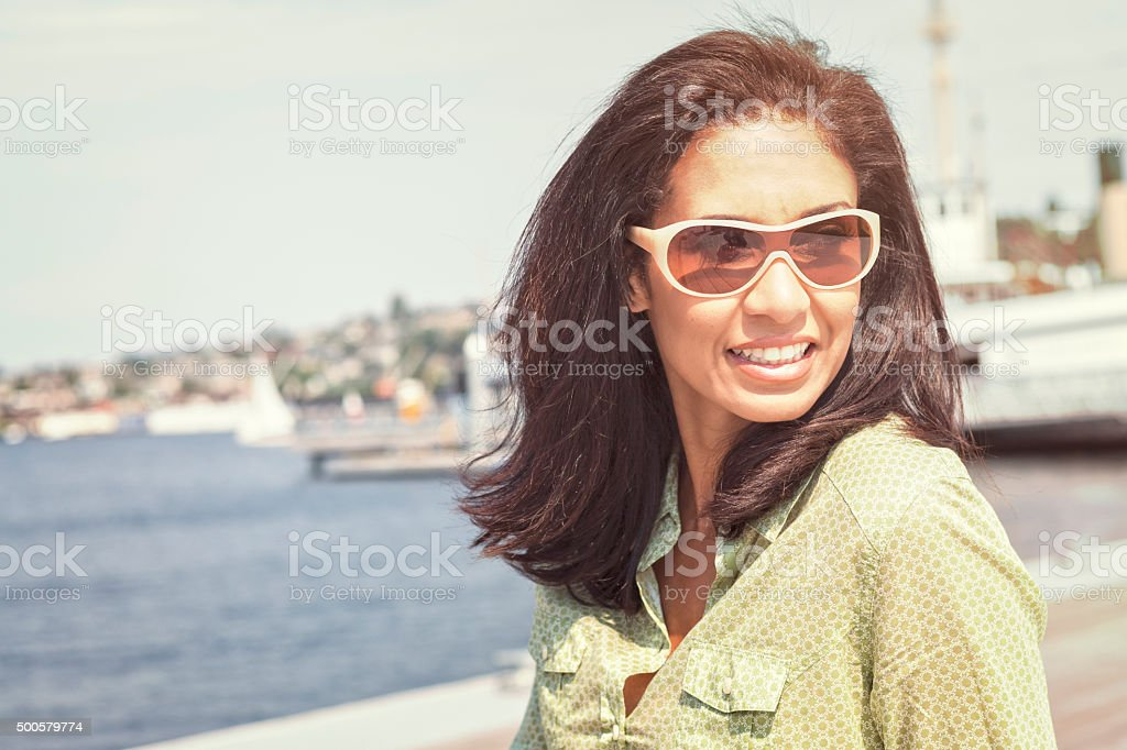 Woman Looks Back Over Her Shoulder stock photo