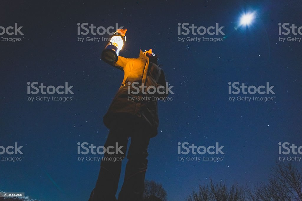 Woman looks comet in the night sky stock photo