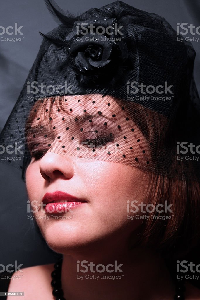 woman looks downwards royalty-free stock photo