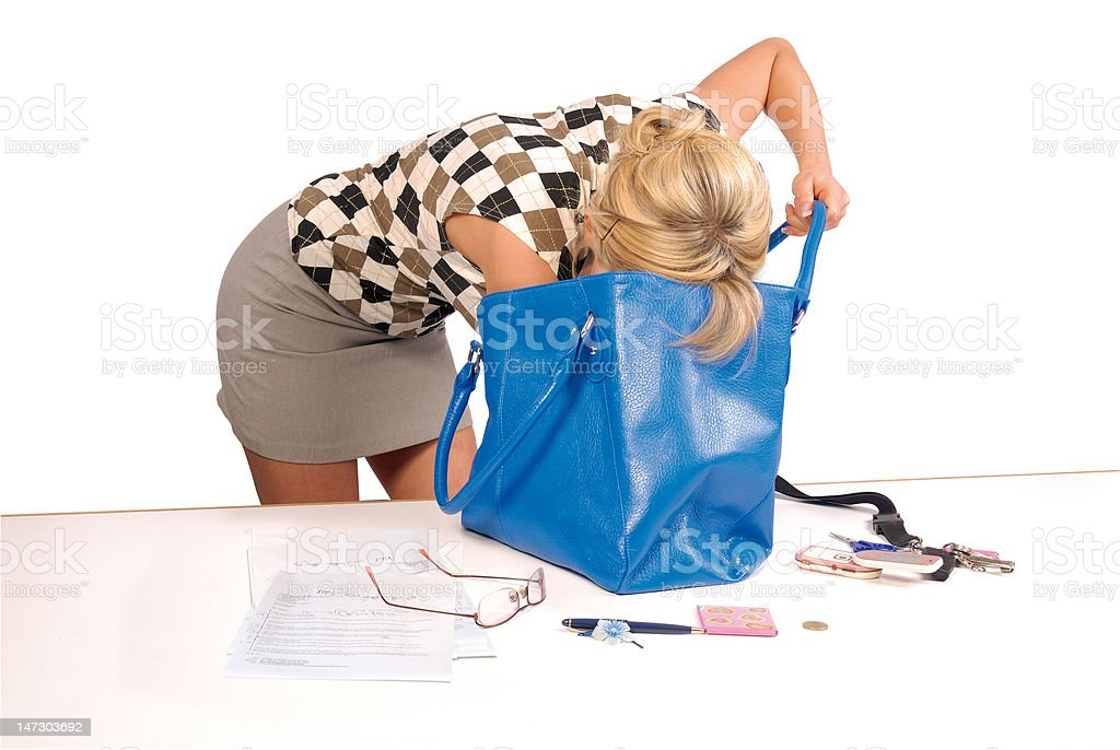 woman looks in her bag stock photo