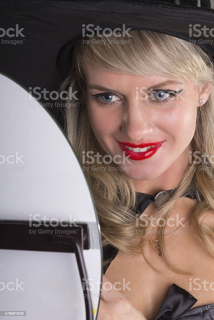 woman looks in mirror and smiling royalty-free stock photo