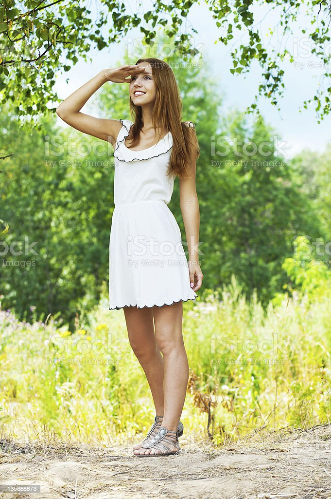 woman looks into the distance royalty-free stock photo