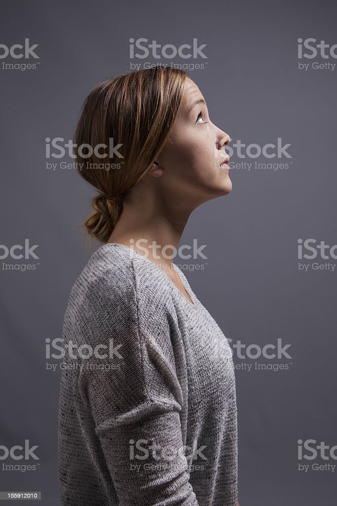 Woman Looks up and Ponders royalty-free stock photo