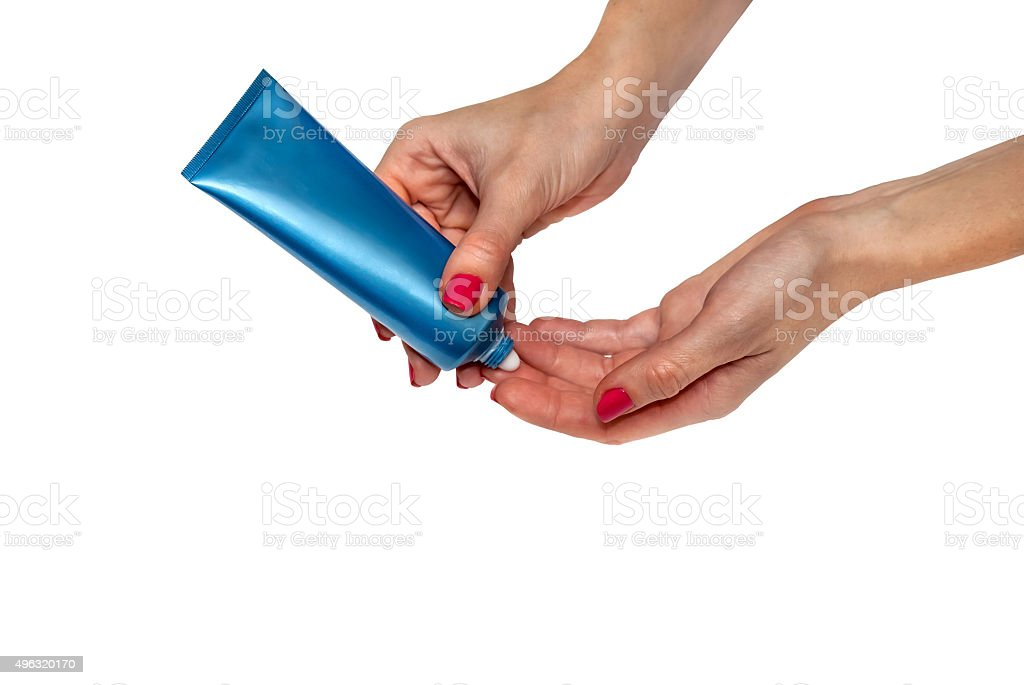 woman lubricates the hands skin with cosmetic cream stock photo