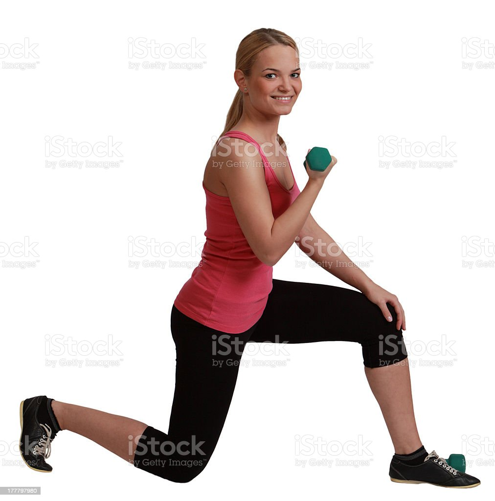 Woman lunging while holding a dumbbell, white background. royalty-free stock photo