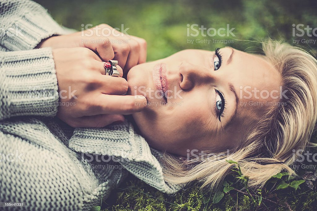 Woman lying down in nature stock photo