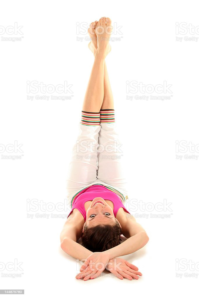 Woman lying down, raising legs in air royalty-free stock photo