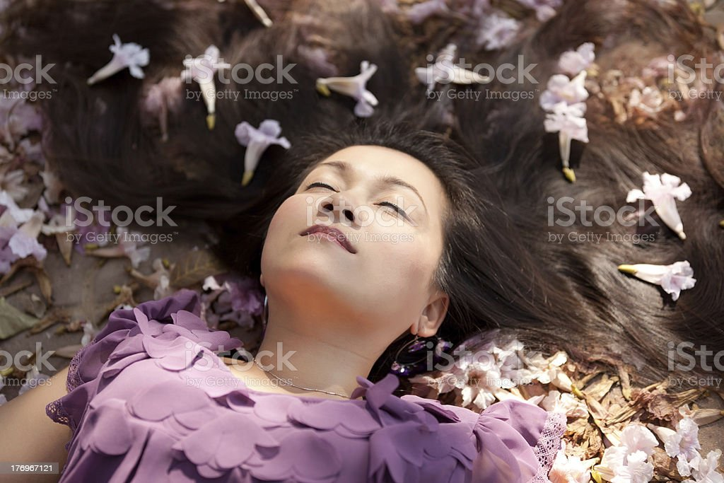 woman lying in flowers royalty-free stock photo