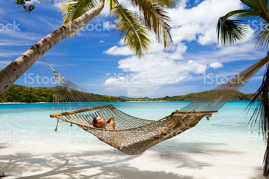 woman lying  in hammock at the Caribbean beach stock photo