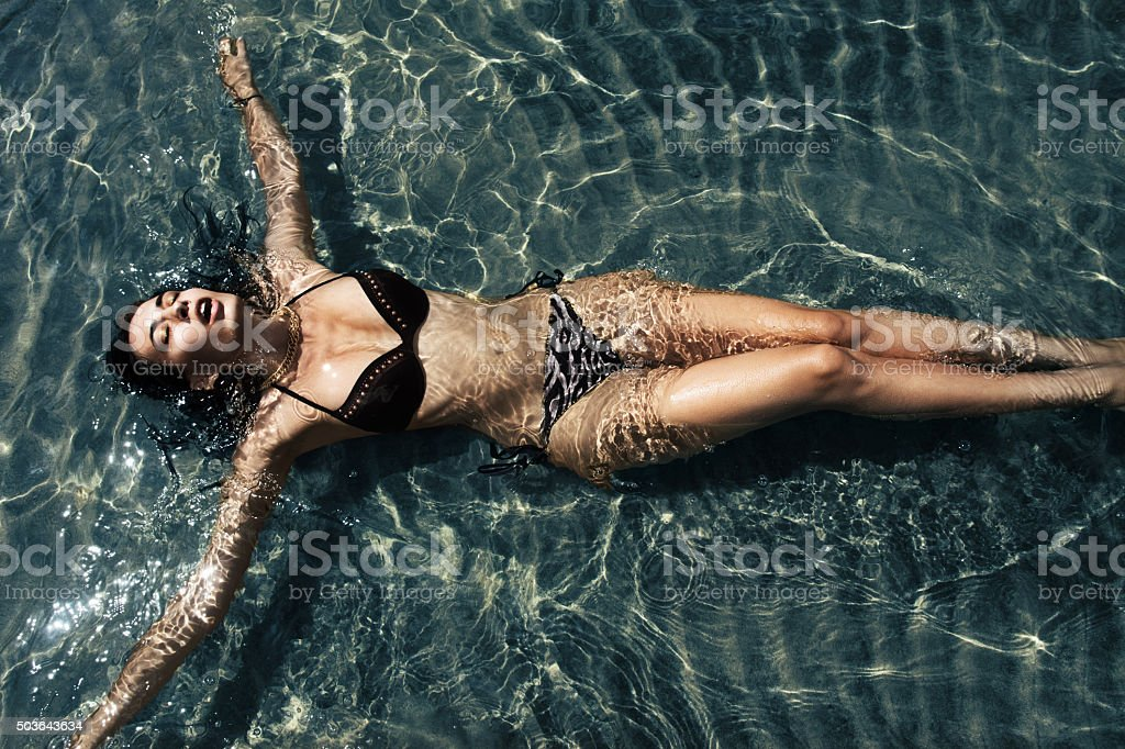 woman lying in water stock photo