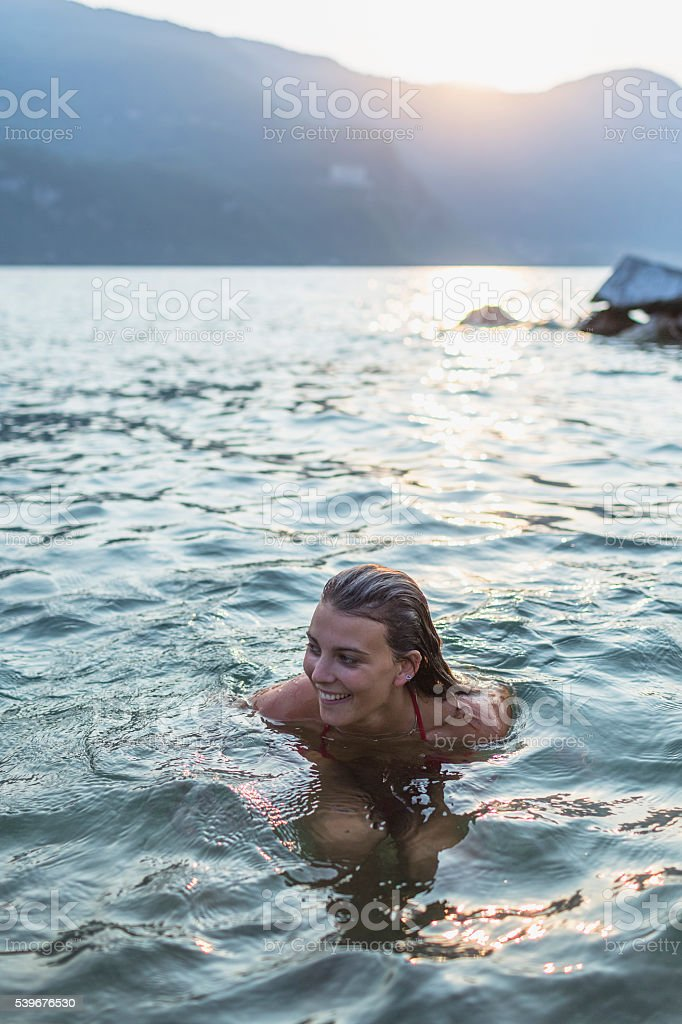 Woman lying in water stock photo