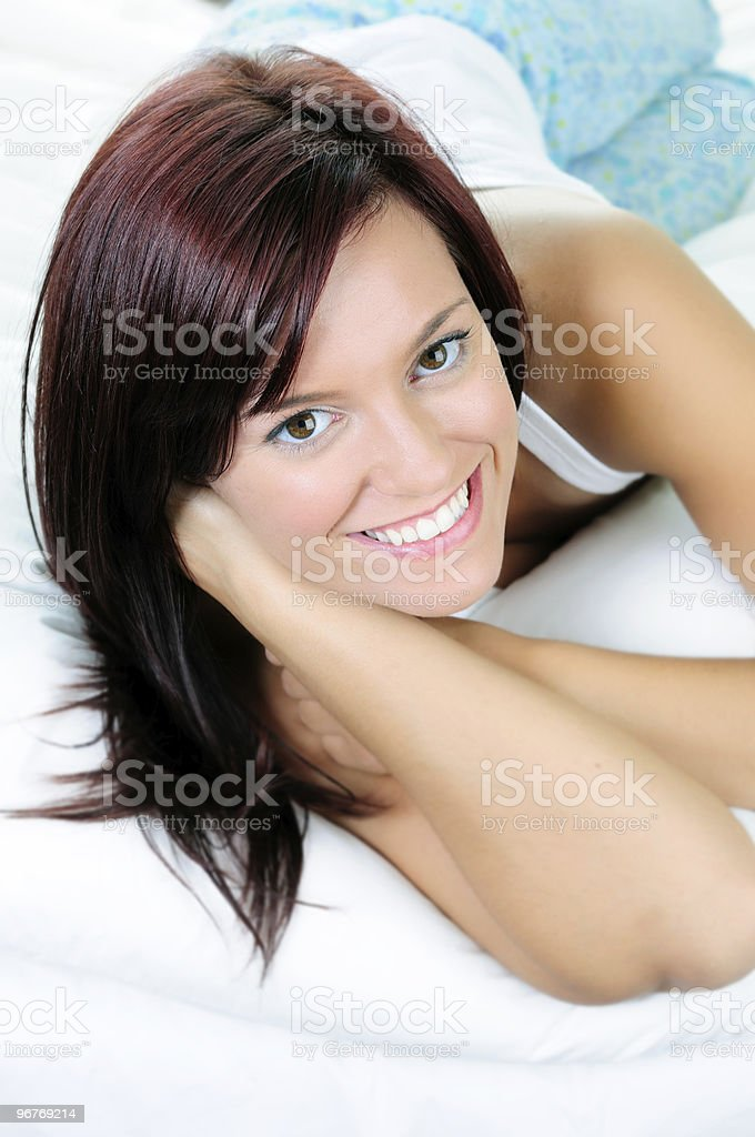 Woman Lying On A Bed royalty-free stock photo