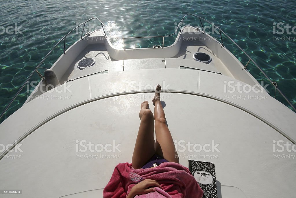woman lying on a boat royalty-free stock photo