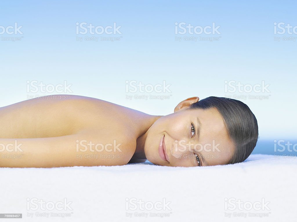 Woman lying on a massage table royalty-free stock photo