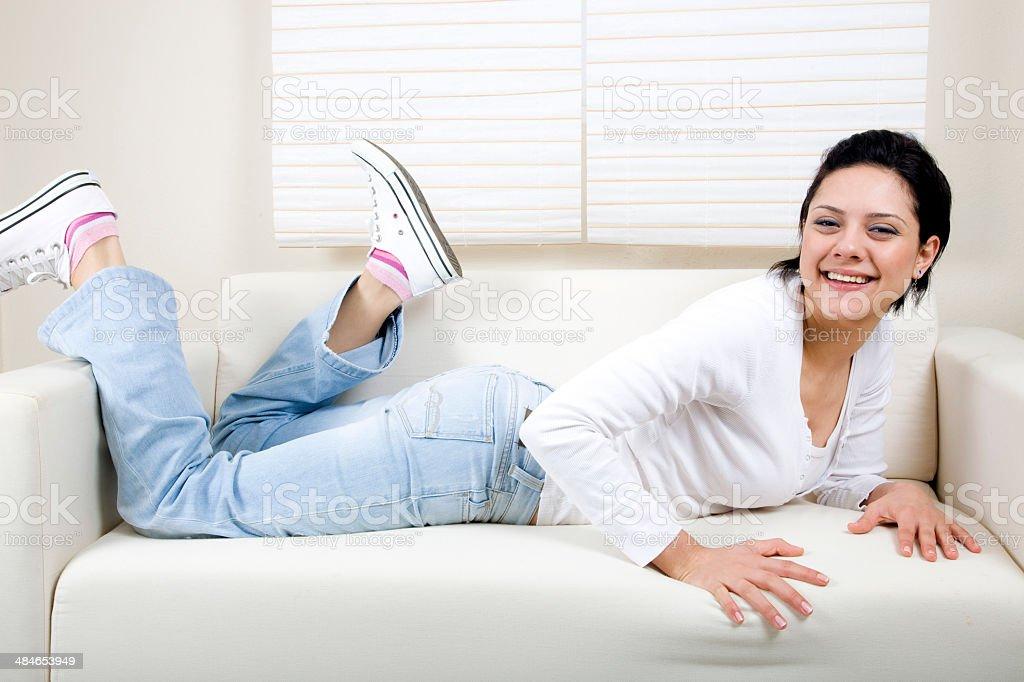 Woman lying on a sofa royalty-free stock photo