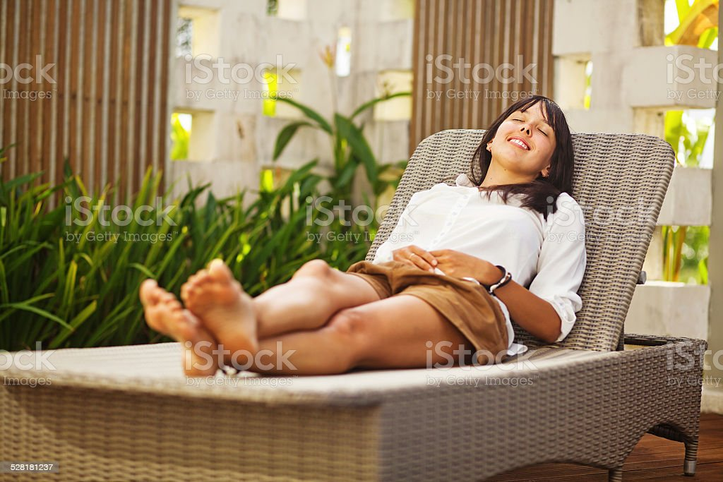 Woman lying on a sunbed stock photo