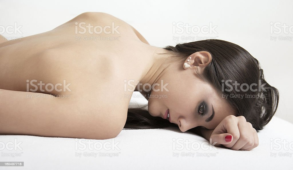 Woman lying on bed royalty-free stock photo
