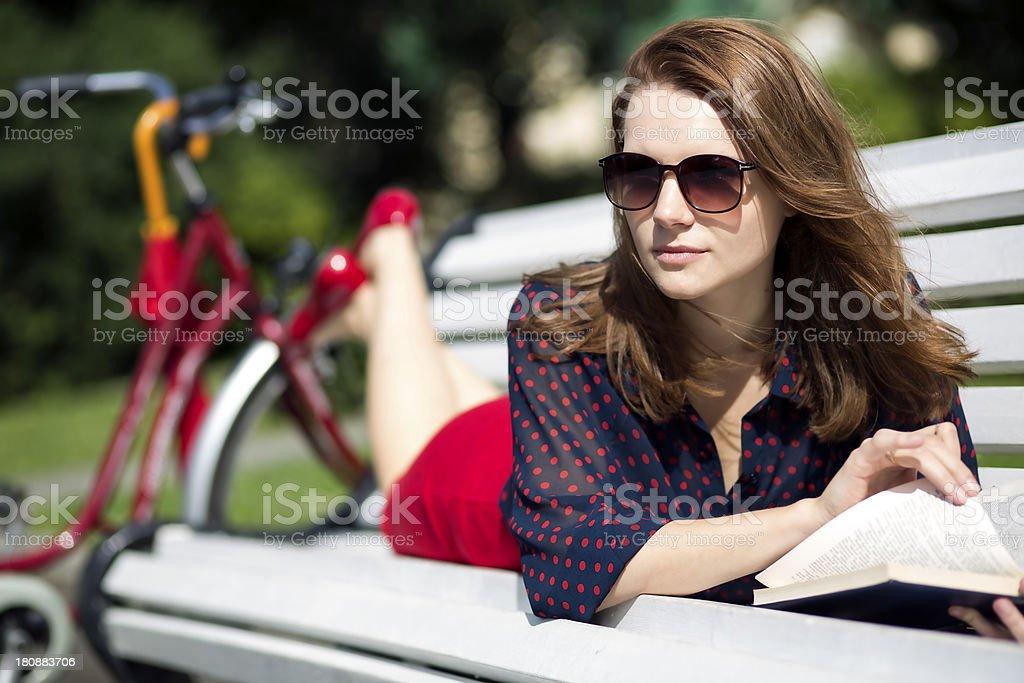 Woman lying on bench and notise something royalty-free stock photo