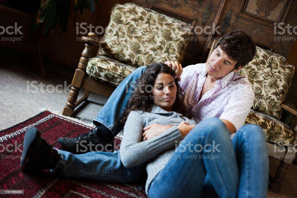 Woman lying on man's legs royalty-free stock photo
