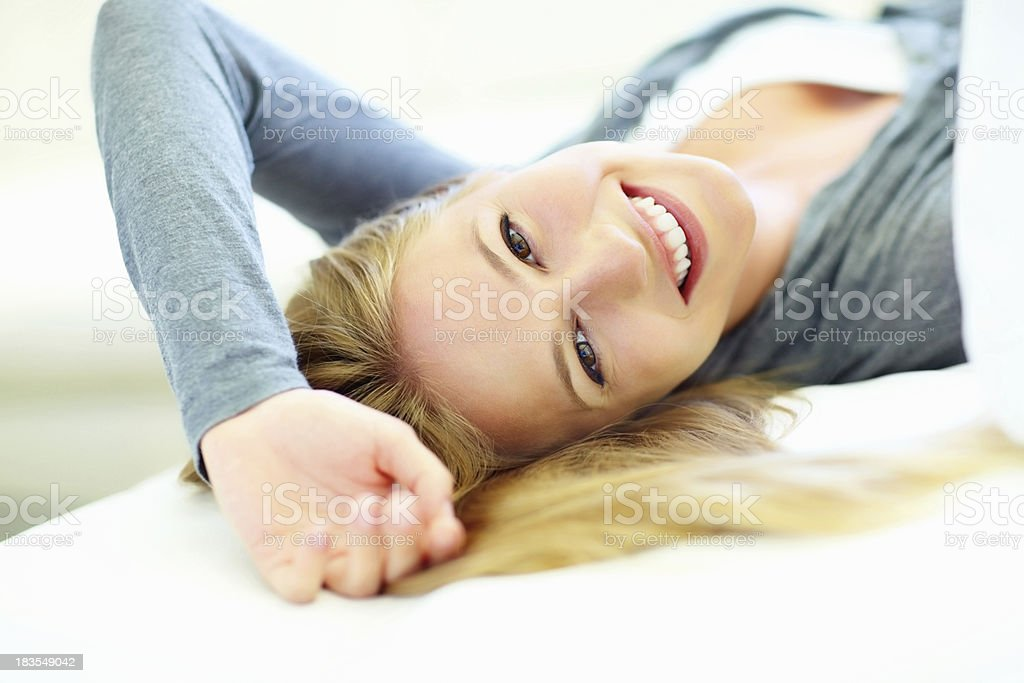 Woman lying on sofa royalty-free stock photo
