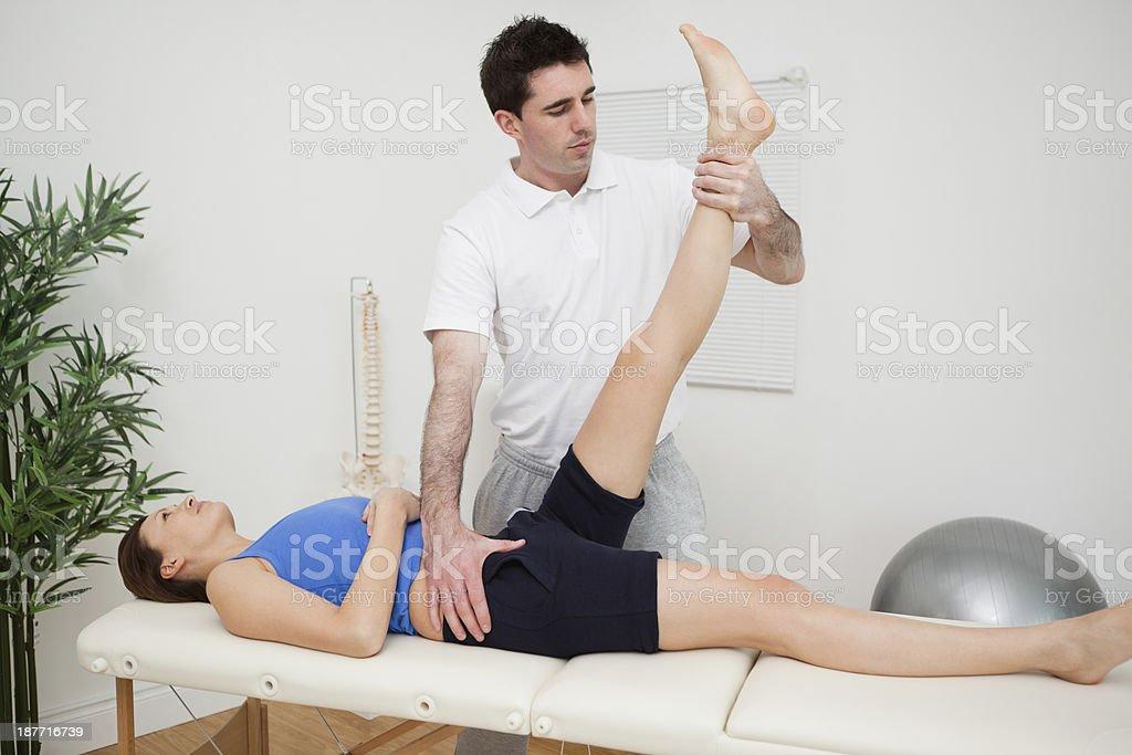 Woman lying on the back raising her leg royalty-free stock photo