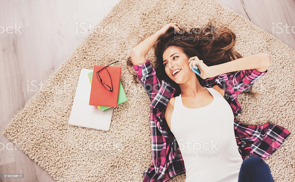 Woman lying on the floor stock photo