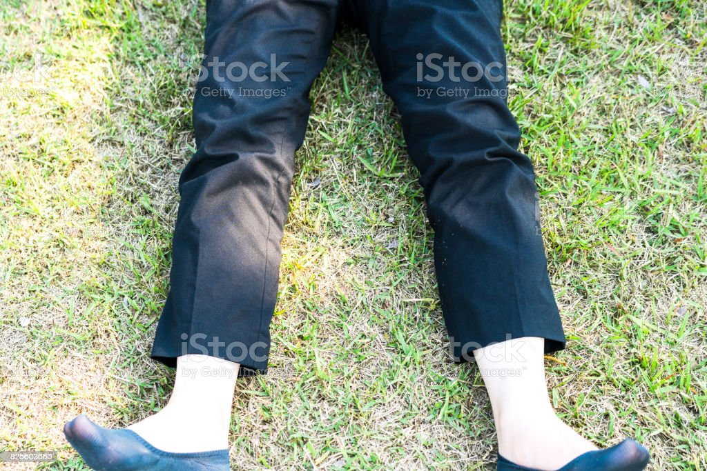 Woman lying on the green field stock photo