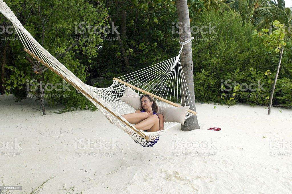 Woman lying on the hammock stock photo