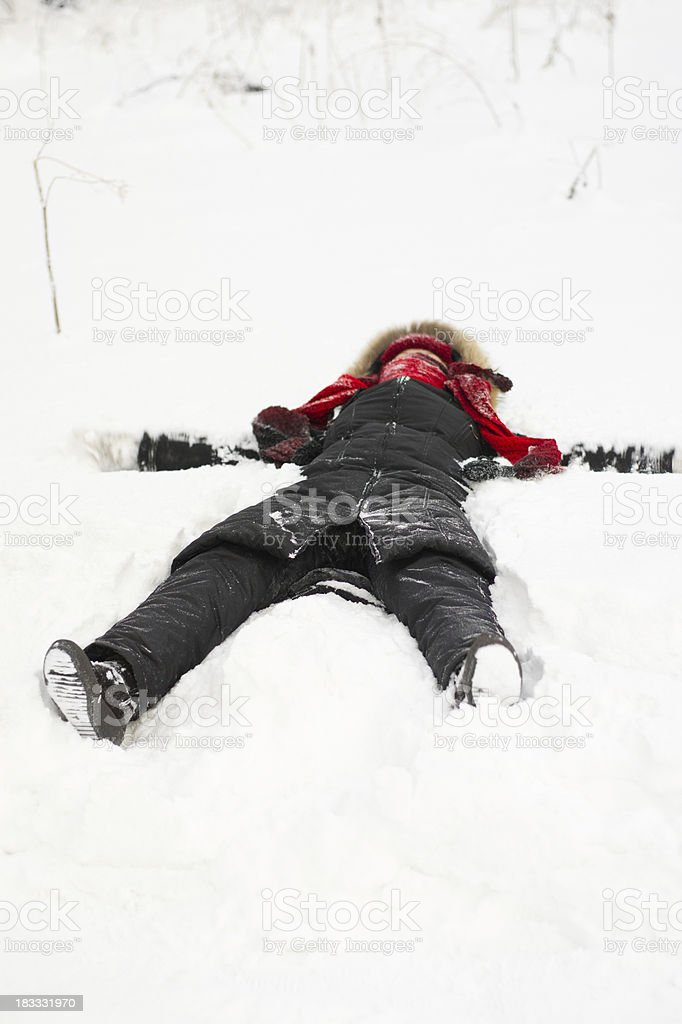 Woman lying on the snow royalty-free stock photo