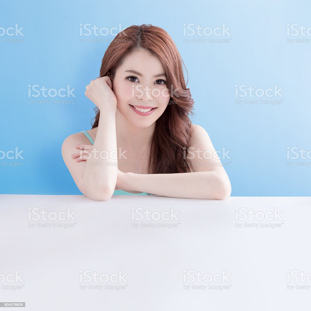 woman lying on white table stock photo