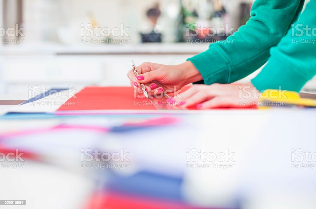 Woman make scrapbook of the papers on the table stock photo