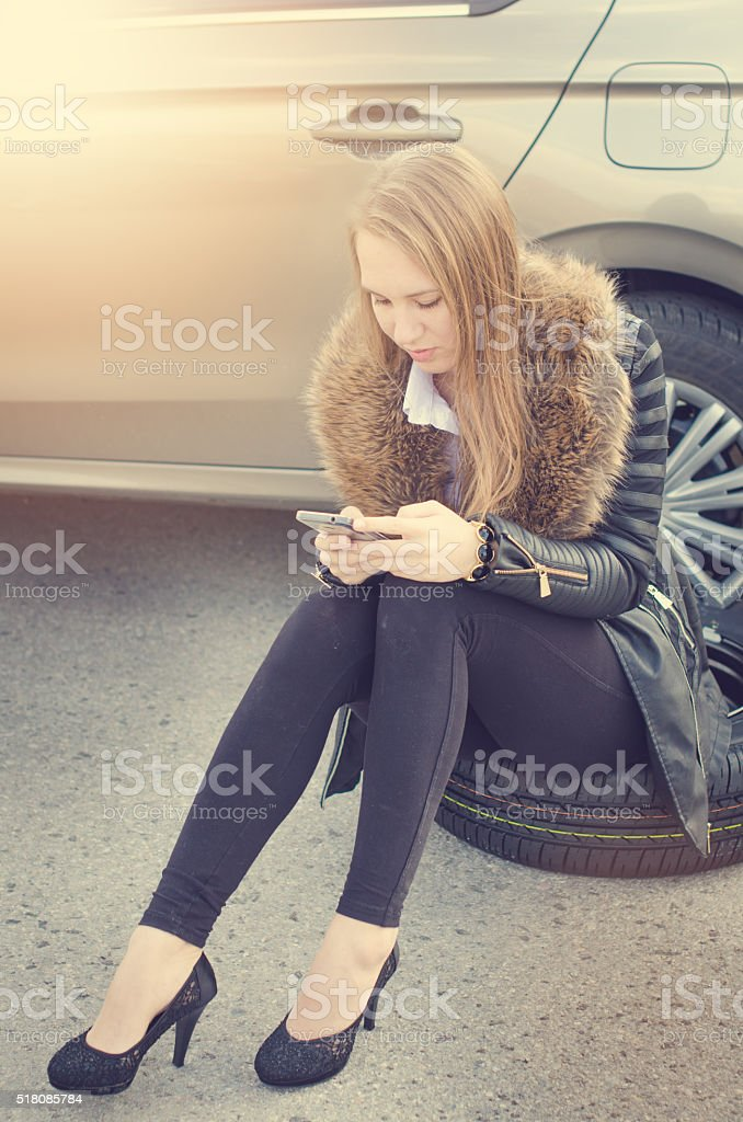 Woman makes a call. Car accident stock photo