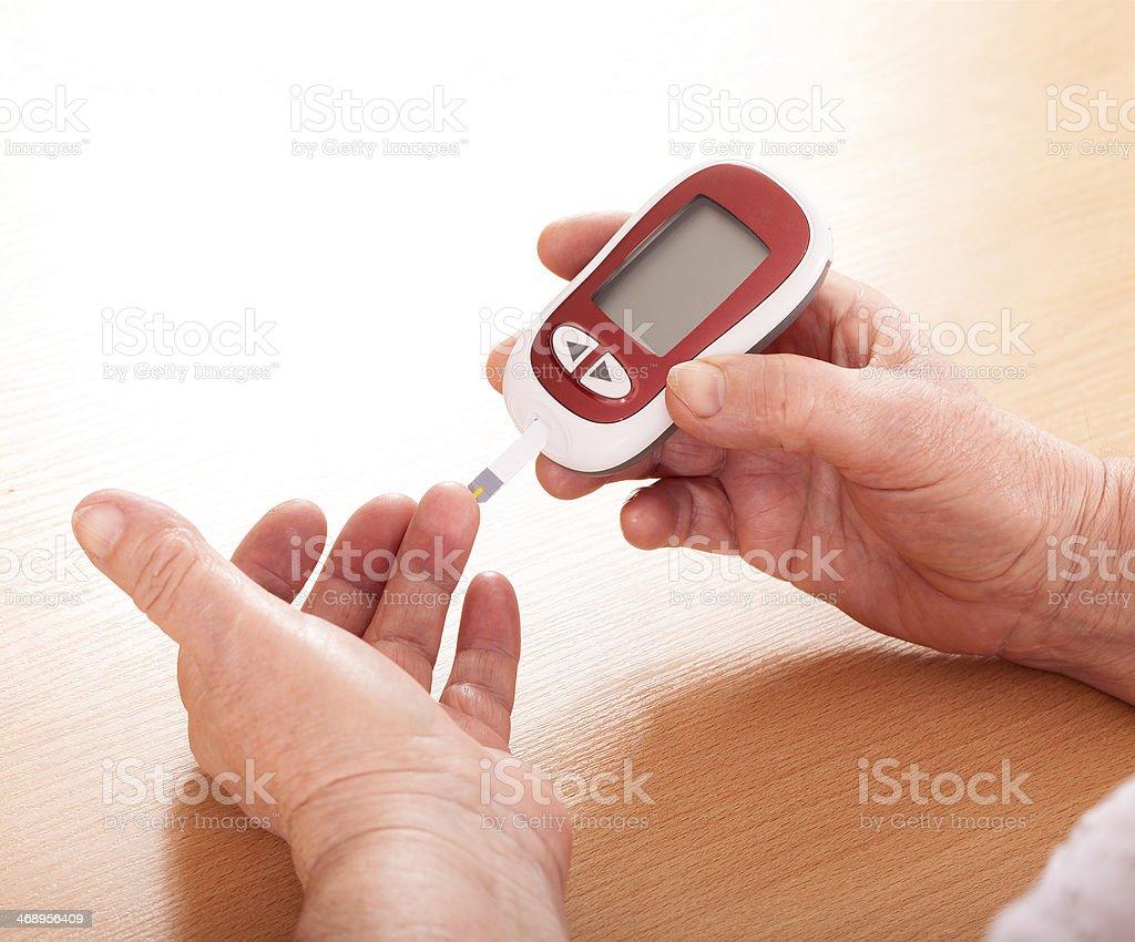 Woman makes testing  high blood sugar. stock photo