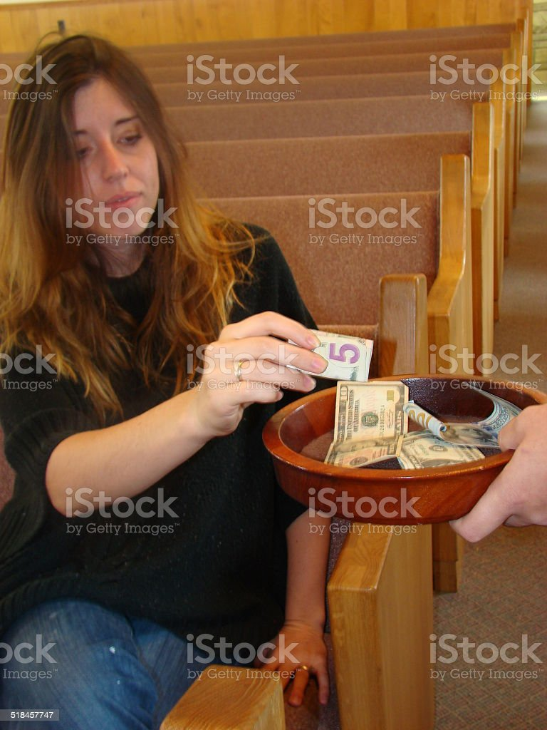 Woman making a Church contribution stock photo