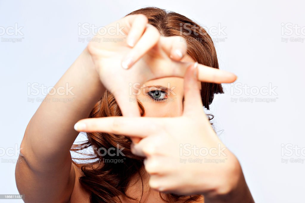 Woman making a frame with her fingers stock photo